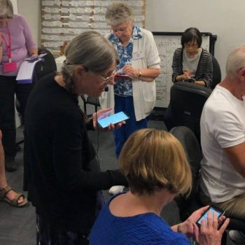 Members learning how to use smartphones